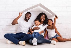 Family,Housing,Concept.,Young,African,American,Parents,With,Two,Children